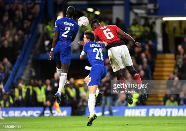 Paul Pogba of Manchester United beats Antonio Ruediger and Cesar Azpilicueta of Chelsea as he scores his team's second goal during the FA Cup Fifth...