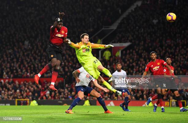 Paul Pogba of Manchester United beats Asmir Begovic of AFC Bournemouth as he scores his team's second goal during the Premier League match between...