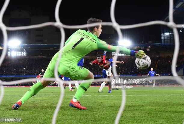Paul Pogba of Manchester United beats Kepa Arrizabalaga of Chelsea as he scores his team's second goal during the FA Cup Fifth Round match between...