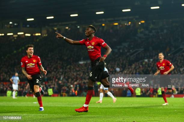 Paul Pogba of Manchester United celebrates after scoring a goal to make it 20 during the Premier League match between Manchester United and...