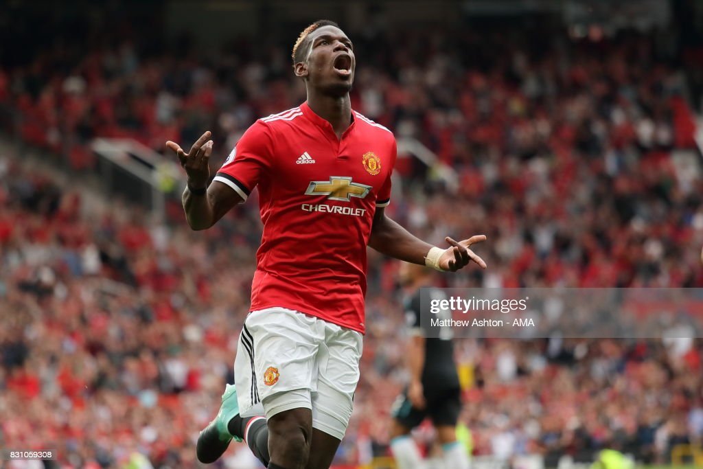 Paul Pogba of Manchester United celebrates after scoring a goal to make it 4-0 during the Premier League match between Manchester United and West Ham United at Old Trafford on August 13, 2017 in Manchester, England.