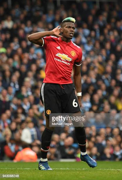 Paul Pogba of Manchester United celebrates after scoring his sides second goal during the Premier League match between Manchester City and Manchester...