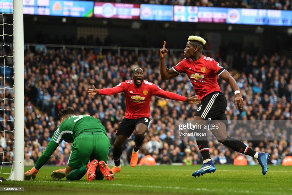 Paul Pogba of Manchester United celebrates after scoring his sides second goal during the Premier League match between Manchester City and Manchester United at Etihad Stadium on April 7, 2018 in Manchester, England.