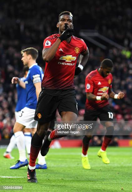 Paul Pogba of Manchester United celebrates after scoring his team's first goal during the Premier League match between Manchester United and Everton...