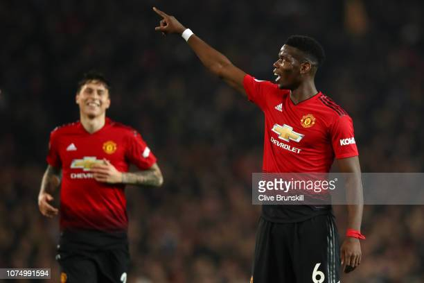 Paul Pogba of Manchester United celebrates after scoring his team's third goal during the Premier League match between Manchester United and...