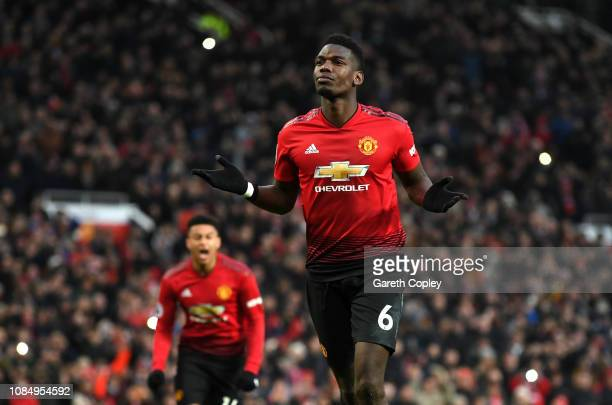 Paul Pogba of Manchester United celebrates after scoring his team's first goal during the Premier League match between Manchester United and Brighton...