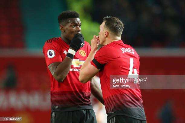 Paul Pogba of Manchester United celebrates after scoring his team's first goal with Ki SungYueng of Newcastle United during the Premier League match...