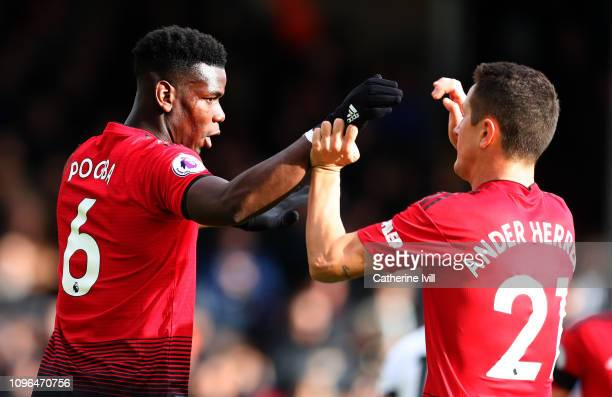 Paul Pogba of Manchester United celebrates after scoring his team's third goal with teammate Ander Herrera during the Premier League match between...