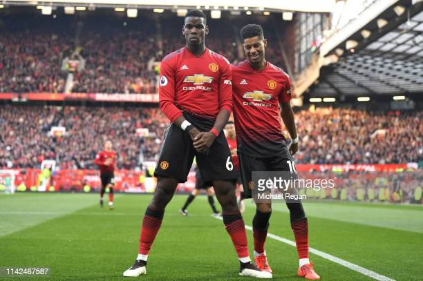 Paul Pogba of Manchester United celebrates after scoring his team's second goal from a penalty with team mate Marcus Rashford during the Premier...