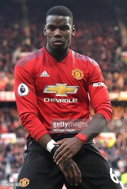 Paul Pogba of Manchester United celebrates after scoring his team's second goal from a penalty during the Premier League match between Manchester...
