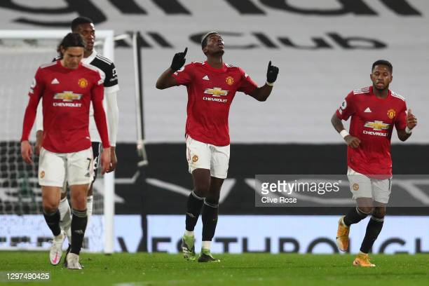Paul Pogba of Manchester United celebrates after scoring their side's second goal during the Premier League match between Fulham and Manchester...
