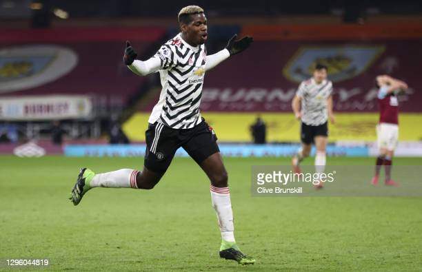 Paul Pogba of Manchester United celebrates after scoring their team's first goal during the Premier League match between Burnley and Manchester...