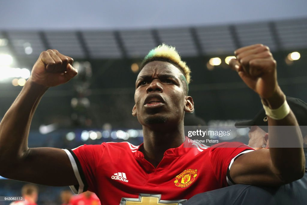 Paul Pogba of Manchester United celebrates after the Premier League match between Manchester City and Manchester United at Etihad Stadium on April 7, 2018 in Manchester, England.