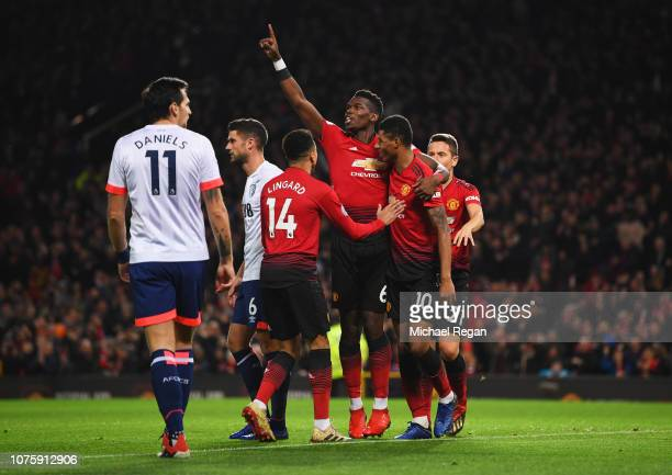 Paul Pogba of Manchester United celebrates as he scores his team's first goal with Jesse Lingard and Marcus Rashford of Manchester United during the...