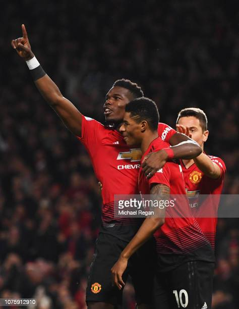 Paul Pogba of Manchester United celebrates as he scores his team's first goal with Marcus Rashford during the Premier League match between Manchester...