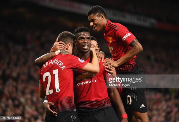 Paul Pogba of Manchester United celebrates as he scores his team's second goal with Ander Herrera and Marcus Rashford during the Premier League match...