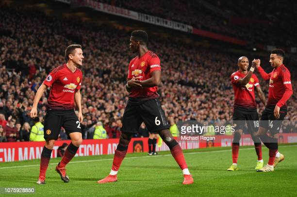 Paul Pogba of Manchester United celebrates as he scores his team's second goal with Ander Herrera and team mates during the Premier League match...