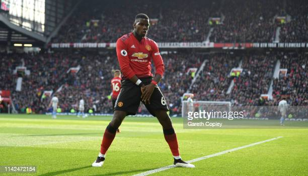 Paul Pogba of Manchester United celebrates as he scores his team's first goal from the penalty spot during the Premier League match between...