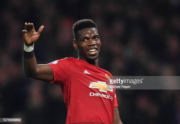 Paul Pogba of Manchester United celebrates as Marcus Rashford of Manchester United scores his team's third goal during the Premier League match...