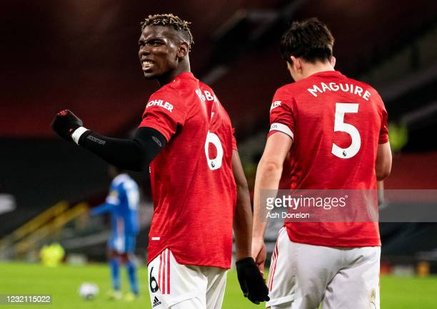 Paul Pogba of Manchester United celebrates assisting his teams second goal during the Premier League match between Manchester United and Brighton &...