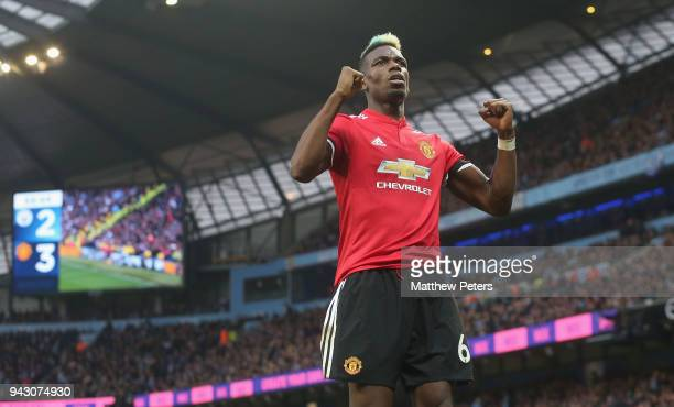 Paul Pogba of Manchester United celebrates Chris Smalling scoring their third goal during the Premier League match between Manchester City and...
