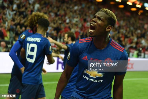 Paul Pogba of Manchester United celebrates his side's second goal by Henrikh Mkhitaryan during the UEFA Europa League final match between Ajax and...