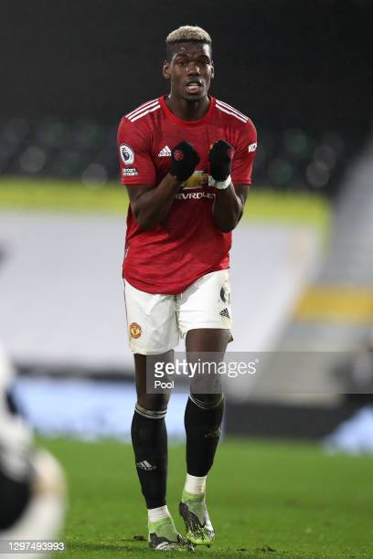Paul Pogba of Manchester United celebrates his side's victory after the Premier League match between Fulham and Manchester United at Craven Cottage...