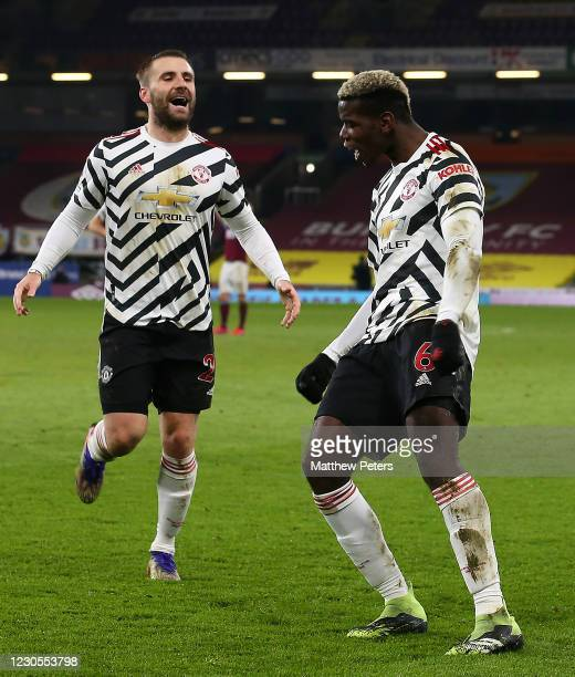 Paul Pogba of Manchester United celebrates scoring a goal to make the score 0-1 with Luke Shaw during the Premier League match between Burnley and...