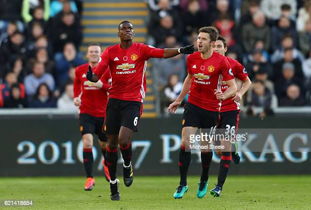 Paul Pogba of Manchester United celebrates scoring his sides first goal with Michael Carrick during the Premier League match between Swansea City and...