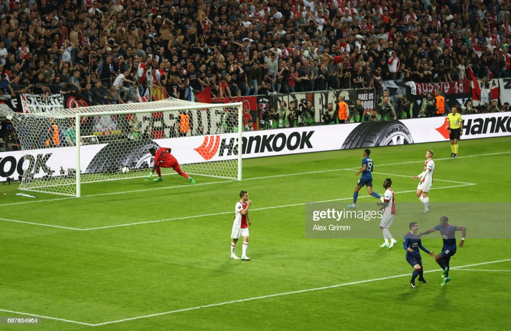 Paul Pogba of Manchester United celebrates scoring his sides first goal with Henrikh Mkhitaryan of Manchester United as Andre Onana of Ajax reacts during the UEFA Europa League Final between Ajax and Manchester United at Friends Arena on May 24, 2017 in Stockholm, Sweden.