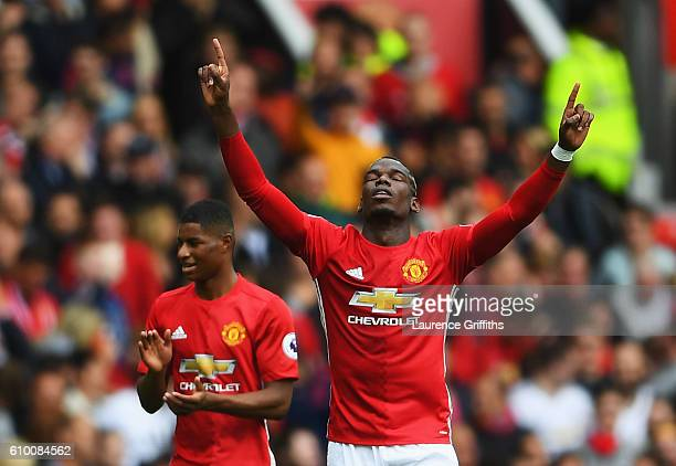 Paul Pogba of Manchester United celebrates scoring his sides fourth goal during the Premier League match between Manchester United and Leicester City...