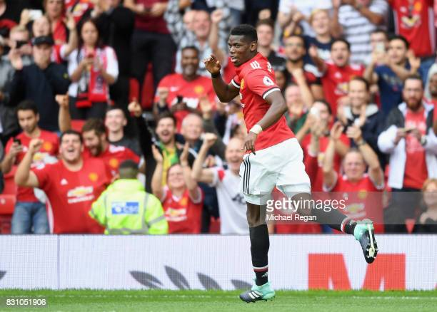 Paul Pogba of Manchester United celebrates scoring his sides fourth goal during the Premier League match between Manchester United and West Ham...