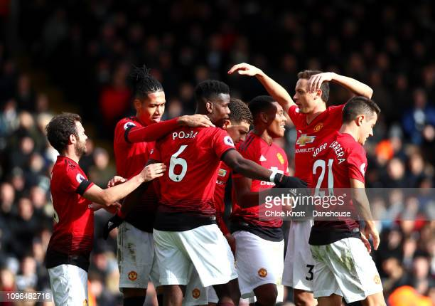 Paul Pogba of Manchester United celebrates scoring his teams third goal during the Premier League match between Fulham FC and Manchester United at...