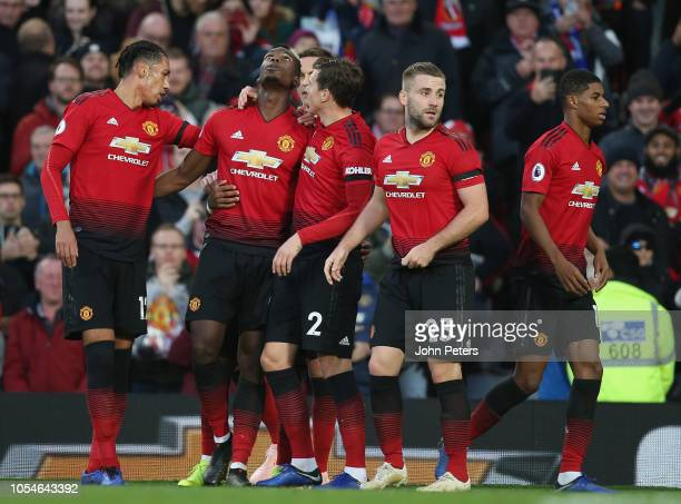 Paul Pogba of Manchester United celebrates scoring their first goal during the Premier League match between Manchester United and Everton FC at Old...