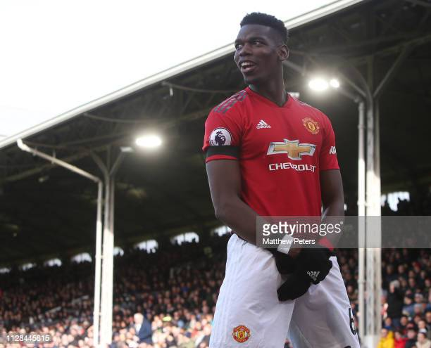 Paul Pogba of Manchester United celebrates scoring their first goal during the Premier League match between Fulham FC and Manchester United at Craven...
