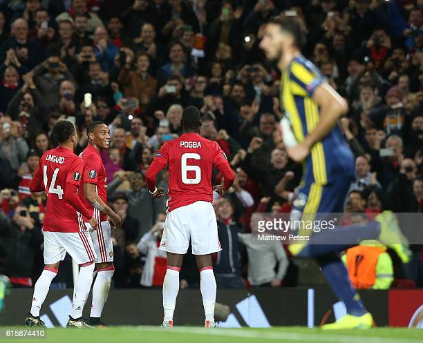Paul Pogba of Manchester United celebrates scoring their first goal during the UEFA Europa League match between Manchester United FC and Fenerbahce...
