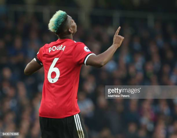 Paul Pogba of Manchester United celebrates scoring their first goal during the Premier League match between Manchester City and Manchester United at...