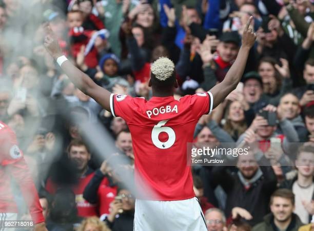 Paul Pogba of Manchester United celebrates scoring their first goal during the Premier League match between Manchester United and Arsenal at Old...