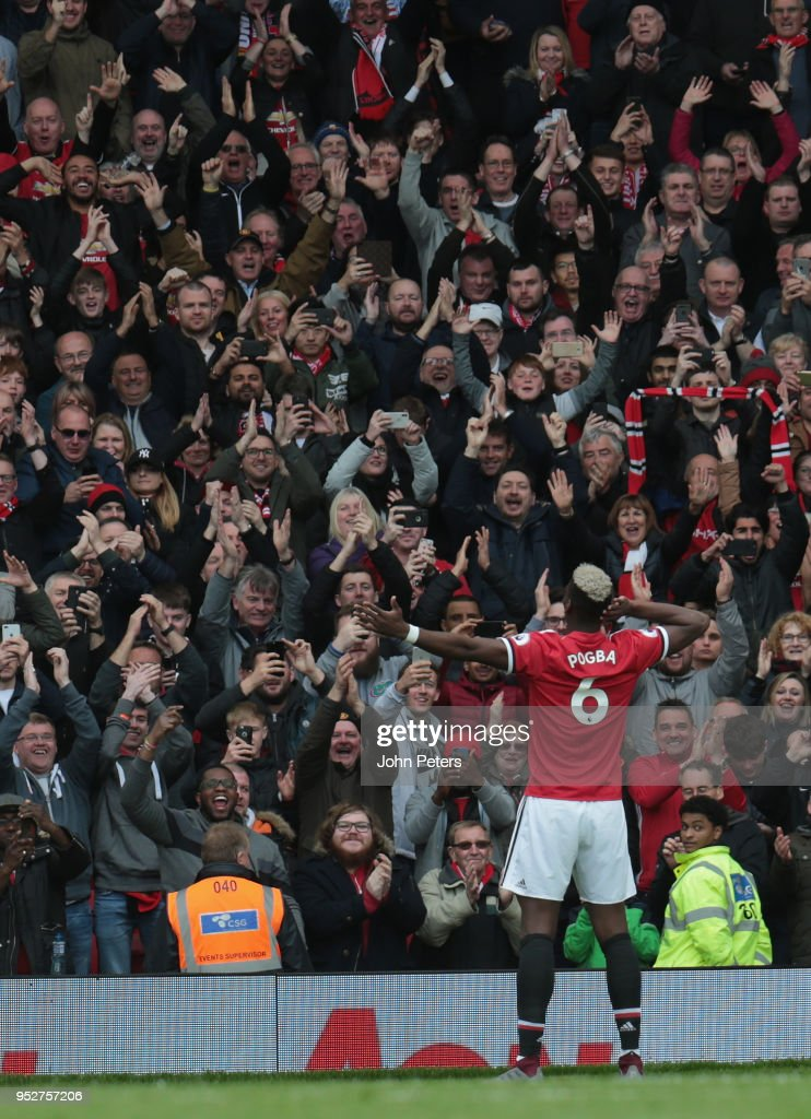 Paul Pogba of Manchester United celebrates scoring their first goal during the Premier League match between Manchester United and Arsenal at Old Trafford on April 29, 2018 in Manchester, England.