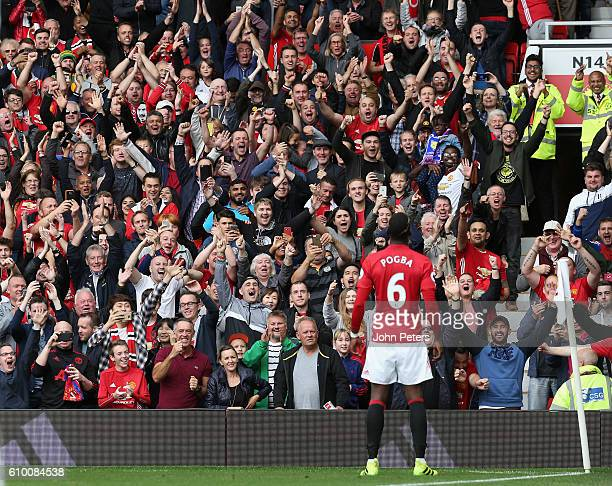 Paul Pogba of Manchester United celebrates scoring their fourth goal in front of the home fans during the Premier League match between Manchester...
