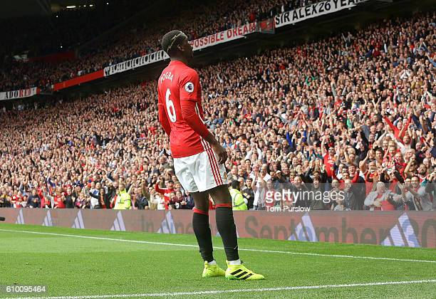 Paul Pogba of Manchester United celebrates scoring their fourth goal during the Premier League match between Manchester United and Leicester City at...
