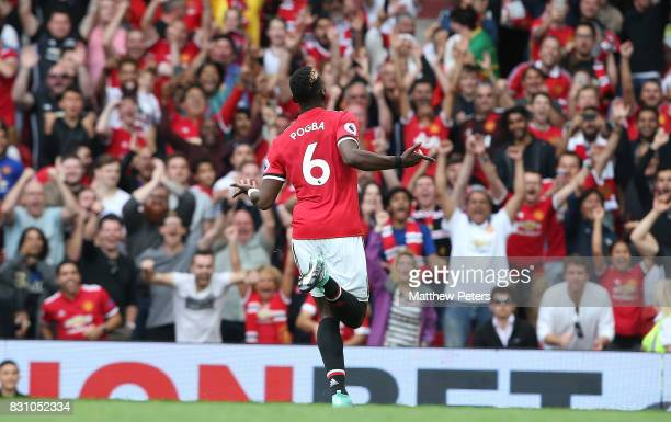 Paul Pogba of Manchester United celebrates scoring their fourth goal during the Premier League match between Manchester United and West Ham United at...