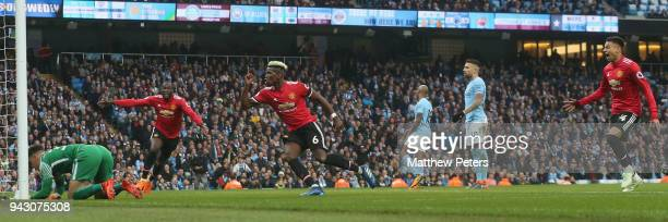 Paul Pogba of Manchester United celebrates scoring their second goal during the Premier League match between Manchester City and Manchester United at...