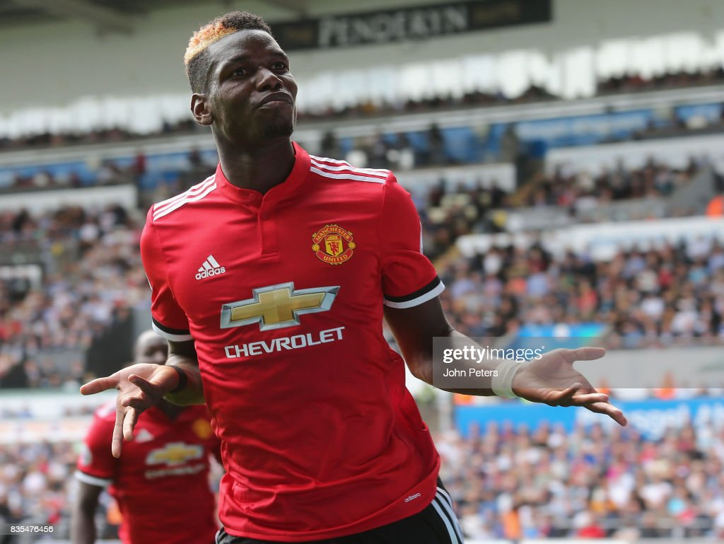 Paul Pogba of Manchester United celebrates scoring their third goal during the Premier League match between Swansea City and Manchester United at Liberty Stadium on August 19, 2017 in Swansea, Wales.