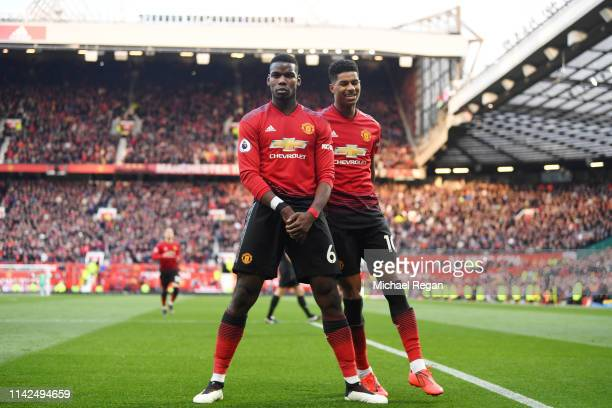 Paul Pogba of Manchester United celebrates scoring to make it 2-1 with team mate Marcus Rashford during the Premier League match between Manchester...
