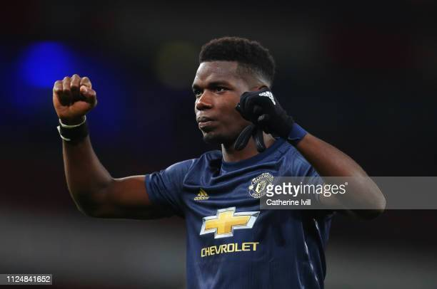 Paul Pogba of Manchester United celebrates victory after the FA Cup Fourth Round match between Arsenal and Manchester United at Emirates Stadium on...