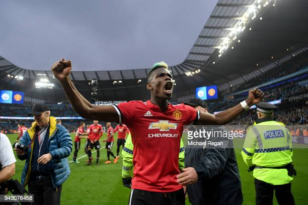 Paul Pogba of Manchester United celebrates victory after the Premier League match between Manchester City and Manchester United at Etihad Stadium on...