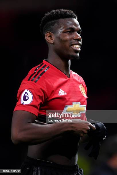Paul Pogba of Manchester United celebrates victory following the Premier League match between Manchester United and Everton FC at Old Trafford on...