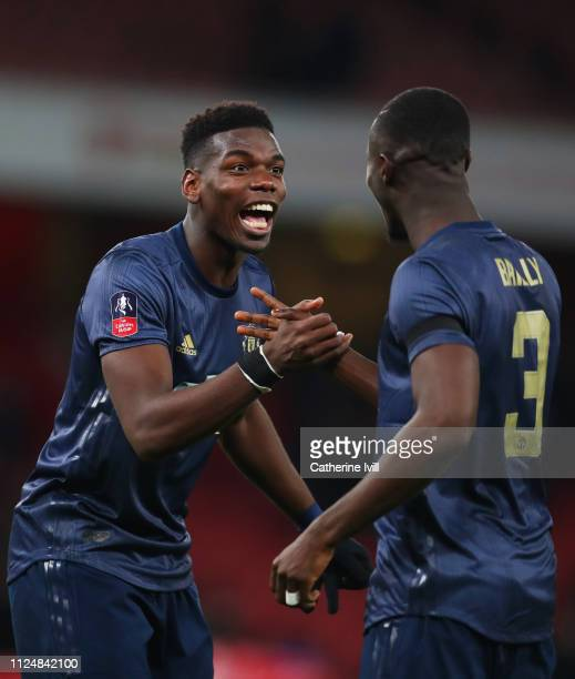 Paul Pogba of Manchester United celebrates victory with Eric Bailly after the FA Cup Fourth Round match between Arsenal and Manchester United at...
