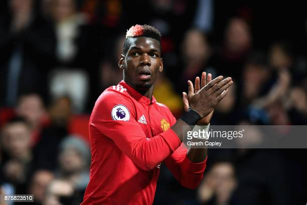 Paul Pogba of Manchester United celebrates when Romelu Lukaku scores their sides fourth goal during the Premier League match between Manchester...